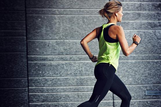 girl running using personal alarm